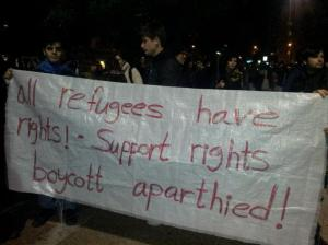 "A sign held in the demonstration against the ""Infiltrators law"", TA, 10/01/12"